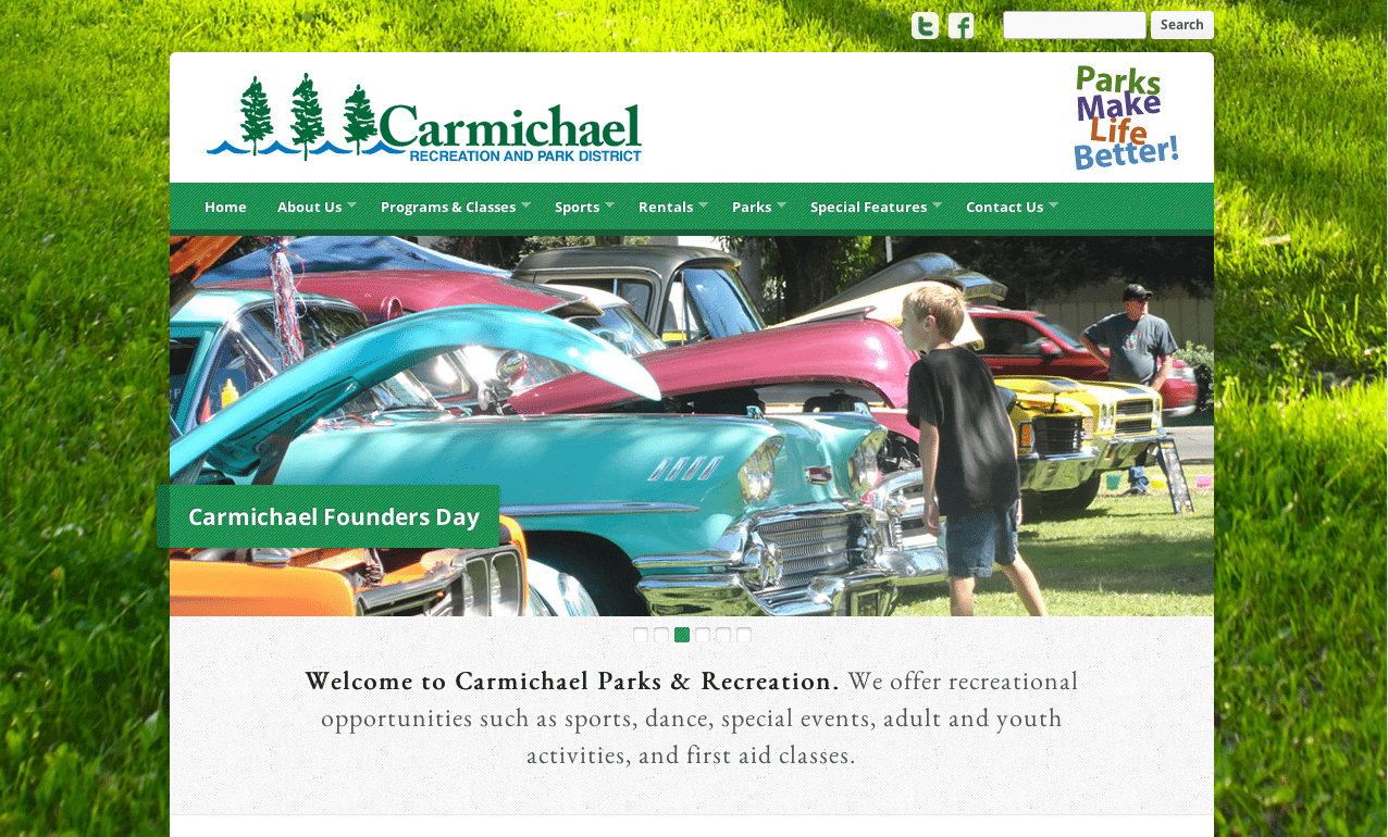 Carmichael Recreation And District Screenshot Of Website's Homepage With People Looking At Classic Cars With Green Grass In Background