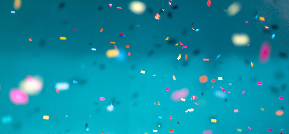 Different Color Confetti Falling In Front Of Teal Background
