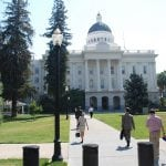 photo of Multiple people in front of the California State Capitol