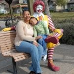 photo of mother, child and Ronald McDonald statue
