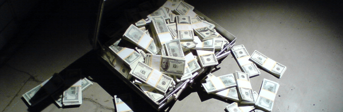 an image of a brief case that has been opened and piles of hundred dollar bills are spilling out of it onto the ground