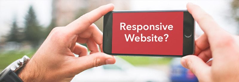 """a POV image of two hands holding a cell phone in landscape mode with the words """"Responsive Website?"""" on it."""