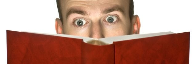 An image of a man reading