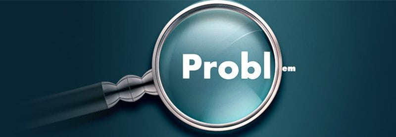 a graphic of a magnifying glass over the top of the word Problems