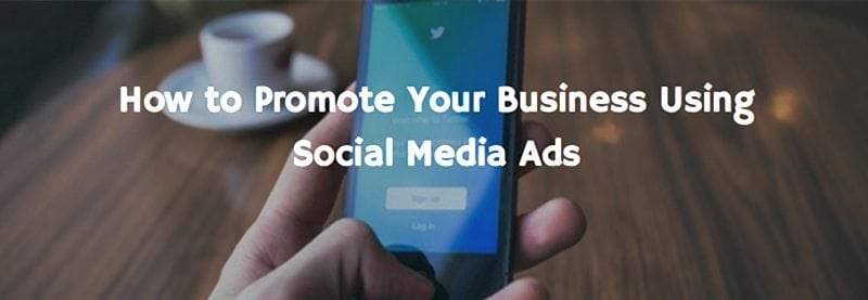 "an image of a person holding a phone and the text overlay reads ""How to promote your business using social media ads"""