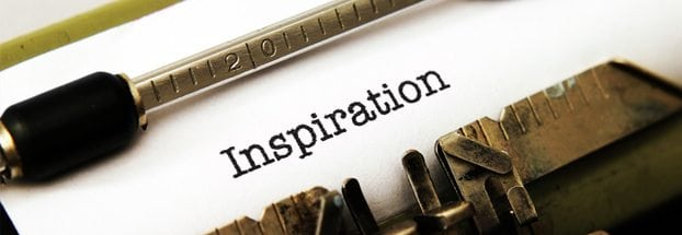 "An image of a typewriter with ""inspiration"""