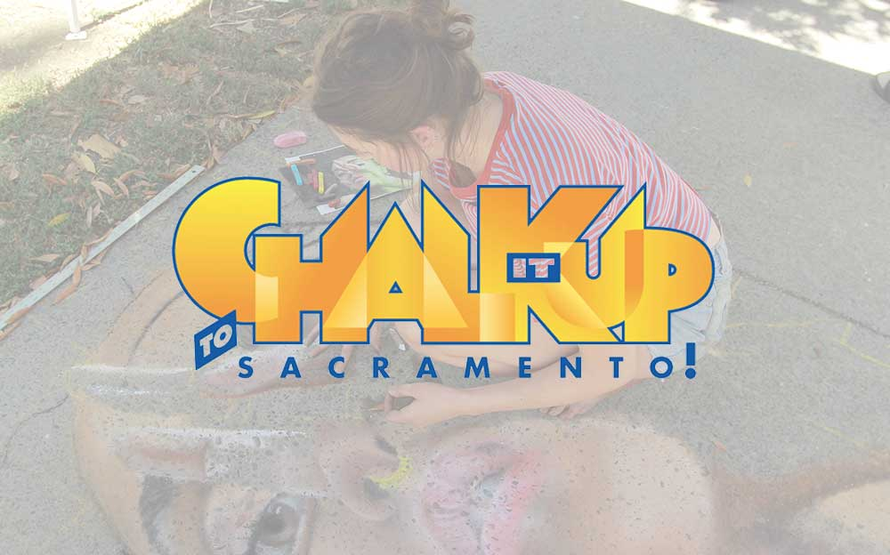 chalk it up logo over image of young woman creating chalk art