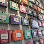 ronald mcdonald house donor wall with small suit cases with donor names or organization name on them