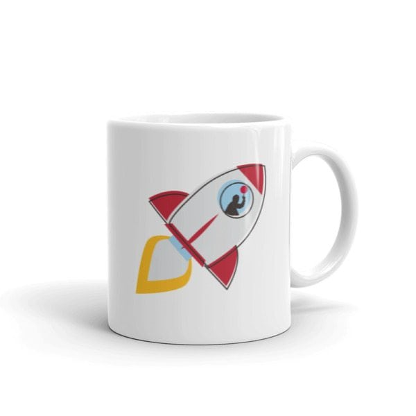 white mug with rocket