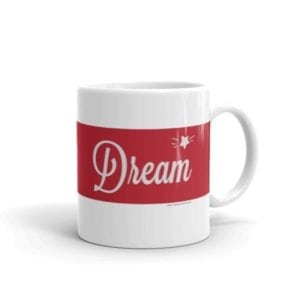 white coffee mug with e red stripe and the word dream