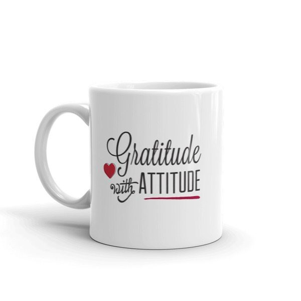 white coffee mug with the text Gratitude with Attitude