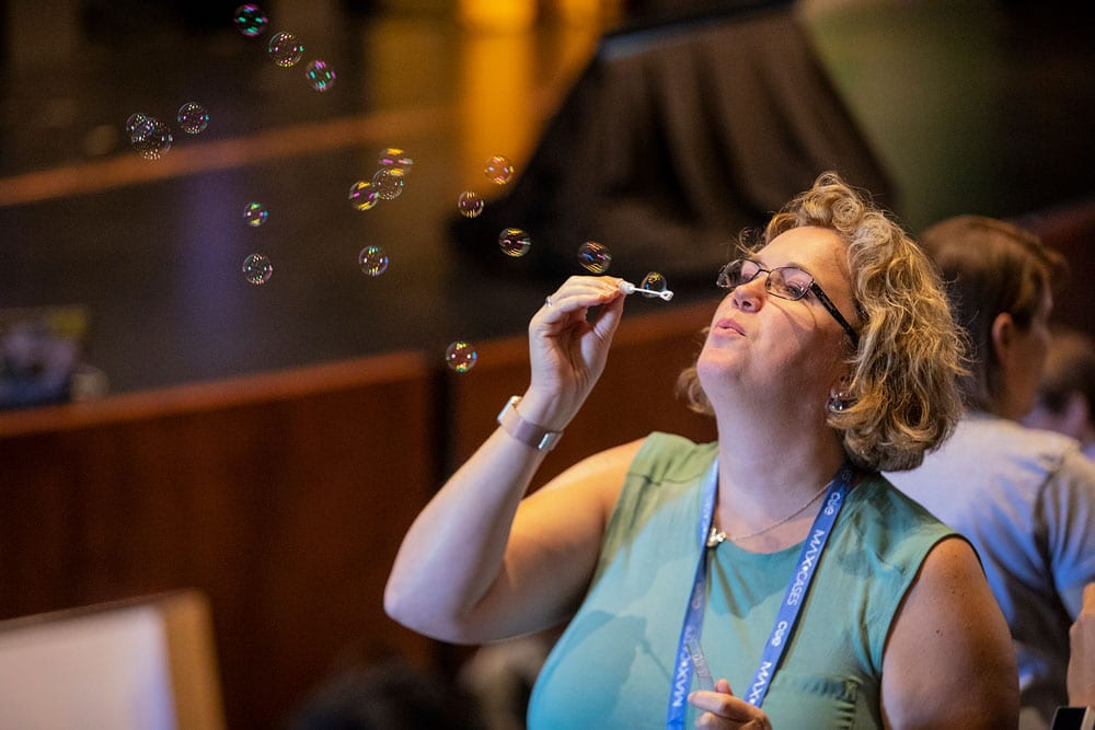 woman blowing bubbles at the conference