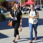 women walking outside at CUE conference