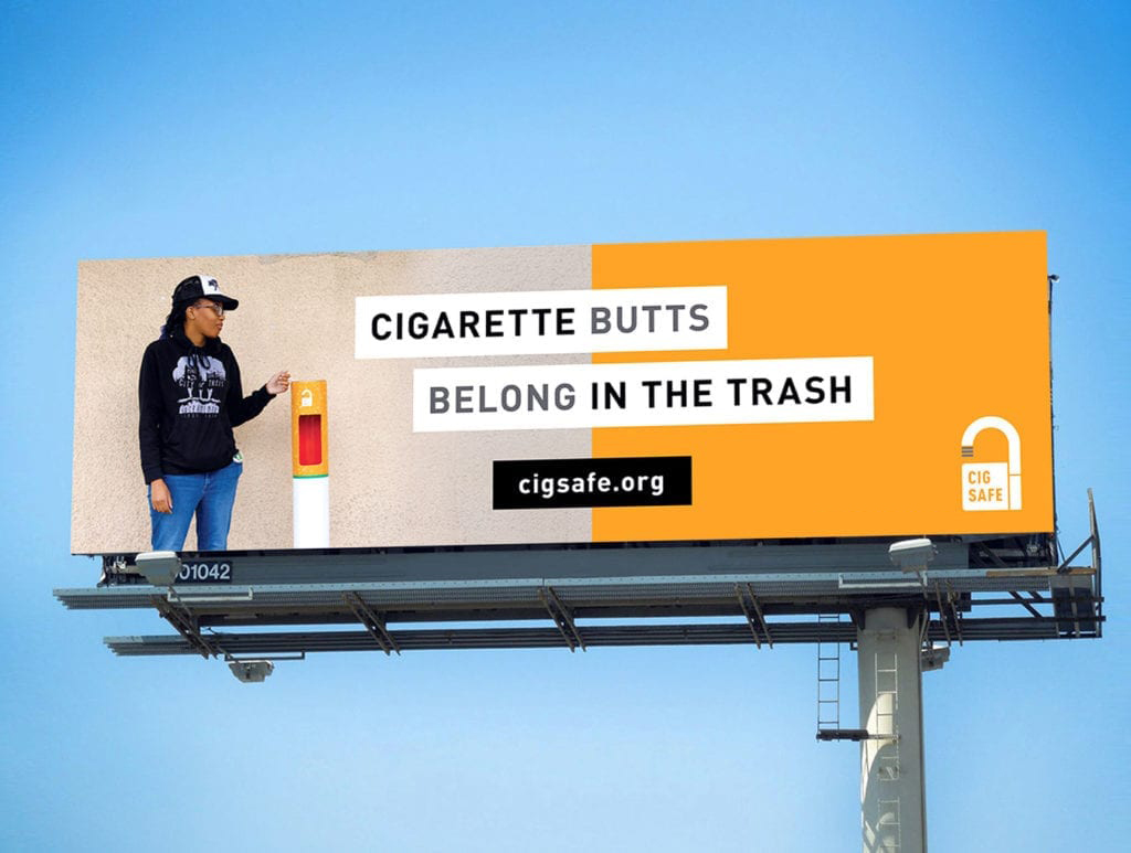 a billboard that says Cigarette Butts Belong in the Trash