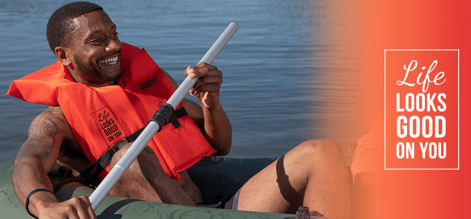 Man Sitting In Raft Holding Oar Smiling Wearing Life Looks Good On You Life Jacket