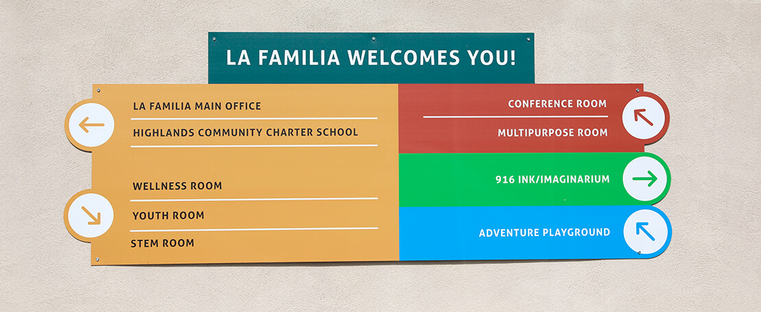La Familia Welcomes You Signage Hanging On Wall