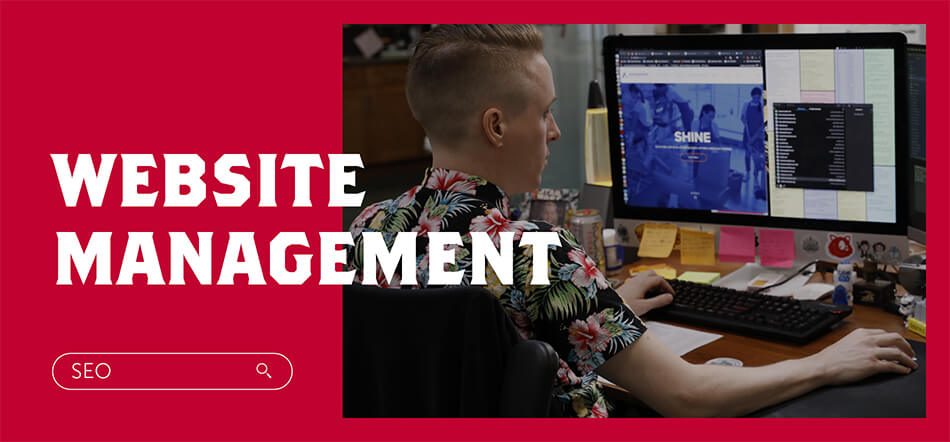 Sacramento Website Management With Person In Background Working On Website Code With SEO Search Bar On The Bottom