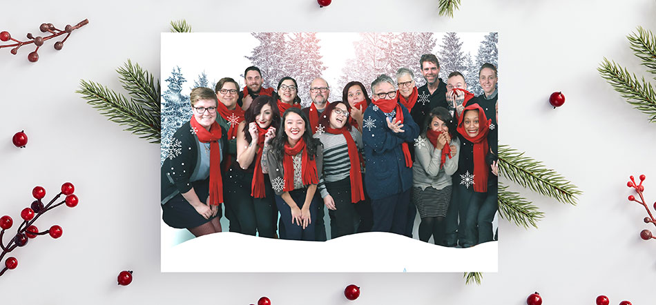 Uptown Studios Holiday Focused Marketing Card With Employees Wearing Red Scarfs And Smiling For Christmas Card