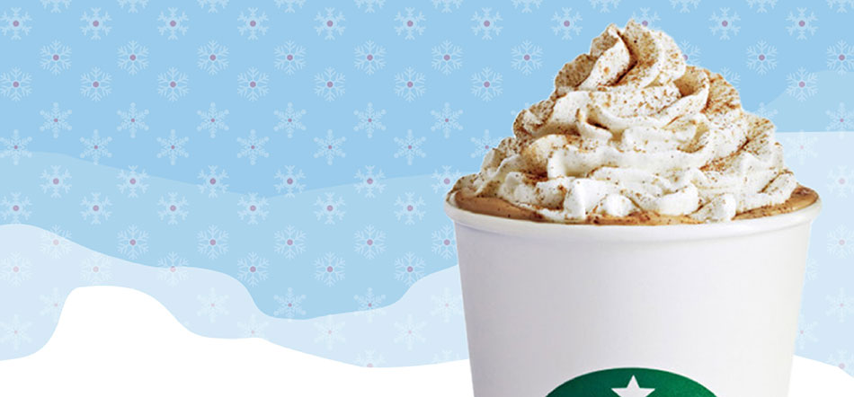Marketing Campaign For The Holidays With Pumpkin Spice Coffee Drink Showed Over Top Of Blue And White Wavy Background