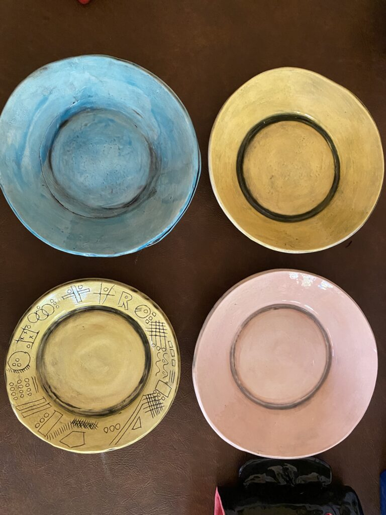Hand Made Four Ceramic Bowls On Top Of Table Created By Tina Reynolds